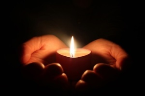 Candle in hand - 700x464 - iStock_000012660966XSmall