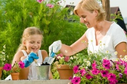 Personal religion - mother and child gardening - 300 px